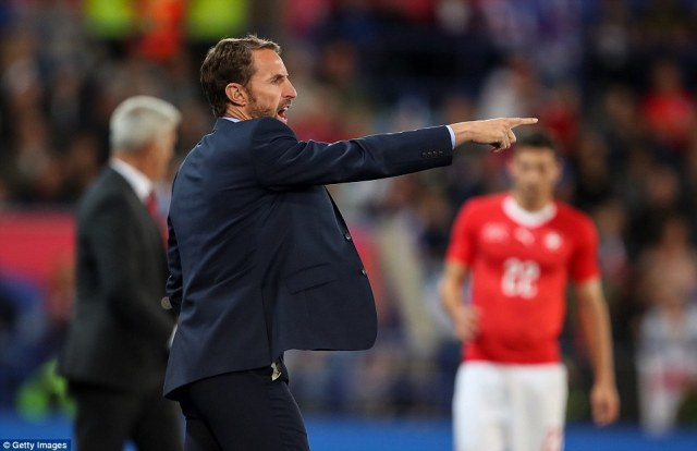 England manager Gareth Southgate barks out instructions to his side as they try to find a way past Switzerland