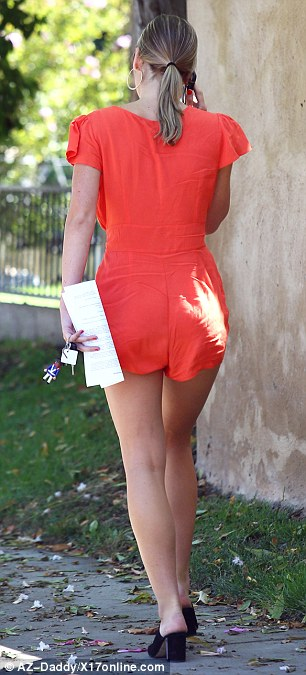 Casual corner: Sexton dressed casually in an orange romper while running errands