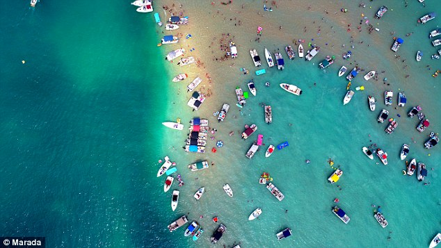 For travellers with less of an urge to party, The Charter Agency notes that sandbars can also be a cool place for 'spending a day in the sun or shade', 'swimming in the water', or gentle paddle boarding