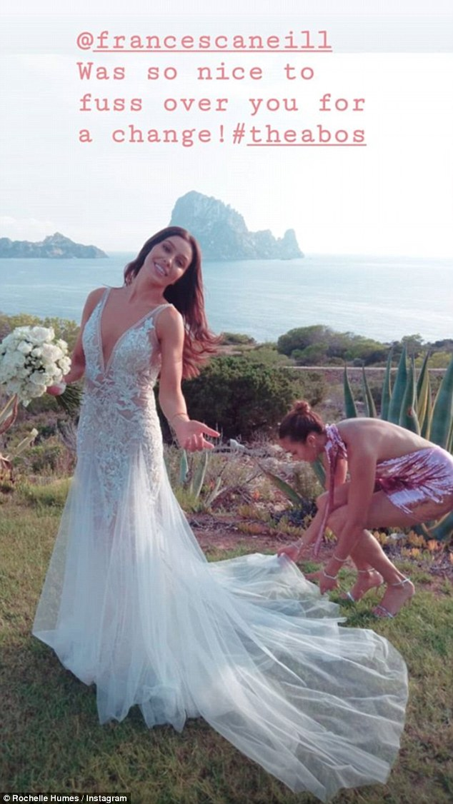 Helping hand: The Mis-teeq singer's pink mini dress highlighted her slender pins while she posed for photos overlooking the stunning island of Es Vedra alongside the blushing bride in her strappy silver sandals