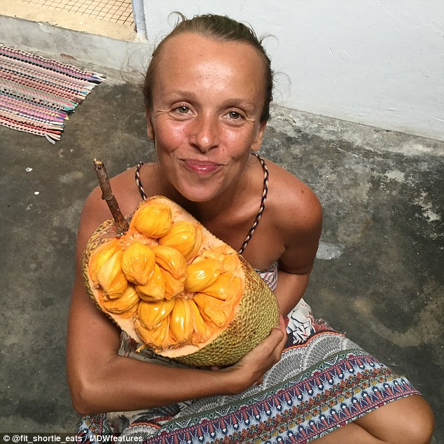 Tina Stoklosa, 39, from Warsaw, Poland, (pictured with a cempedak fruit in Bali) has revealed how she has only eaten fruit for five years, after trying the diet as a pre-Christmas cleanse
