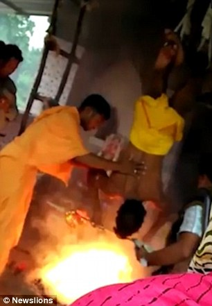 An assistant to the priest poured clarified butter onto the fire
