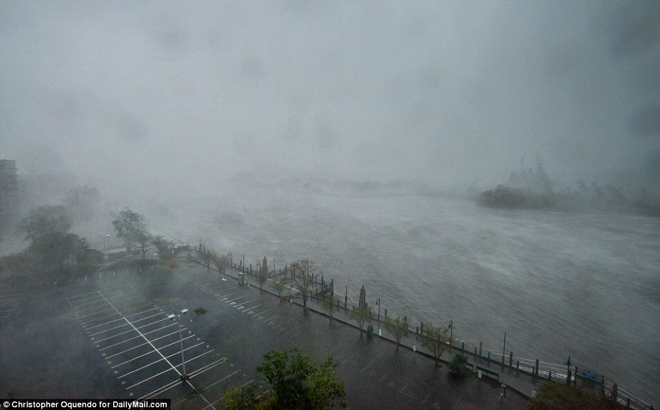 Florence's fiercest winds will linger around the coast for hours since the storm was moving forward at only 6 mph. Pictured: The hurricane arriving at Wilmington on Friday