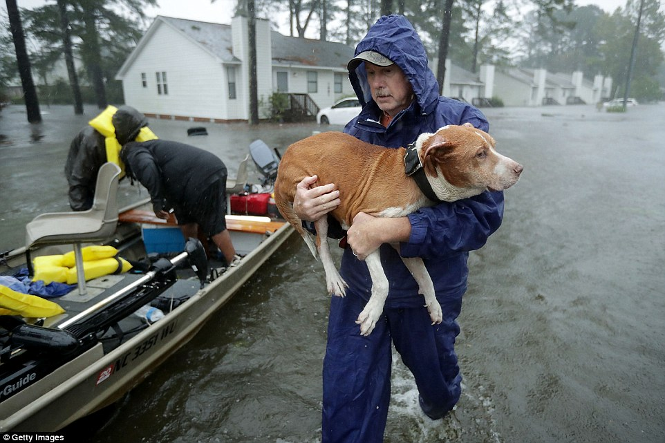Flooding from the heavy rain is forcing hundreds of people to call for emergency rescues in the area around New Bern, North Carolina, which sits at the confluence of the Nuese and Trent rivers