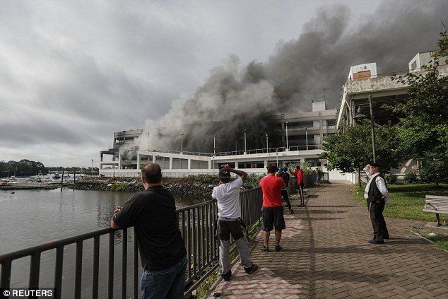 Dramatic video and pictures show thick black smoke billowing from the scene