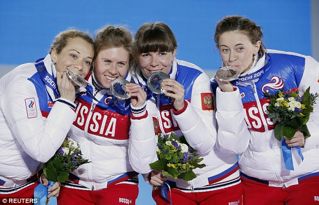 Silver medalists Russia's Olga Zaitseva, Yana Romanova, Ekaterina Shumilova and Olga Vilukhina (left to right) pose on the podium during the victory ceremony for the women's biathlon 4 x 6km event at the 2014 Sochi Winter Olympics February 22, 2014. The group is currently suing GrigoryRodchenkov, claiming he defamed them by linking them to doping