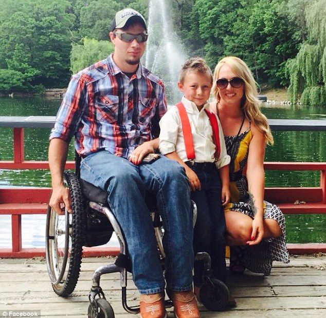Doctors approached Chinnock with some research they were working on, which involved placing an an electrode just below his injured area. Pictured: Chinnock with his wife Jennifer and his son