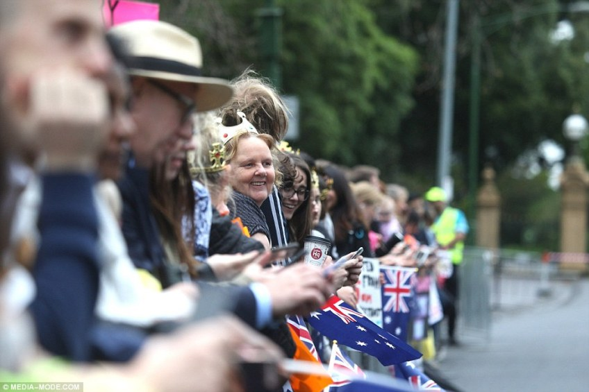 Royal fans are seen eagerly awaiting the arrival of the The Duke and Duchess of Sussex in Melbourne on Thursday morning