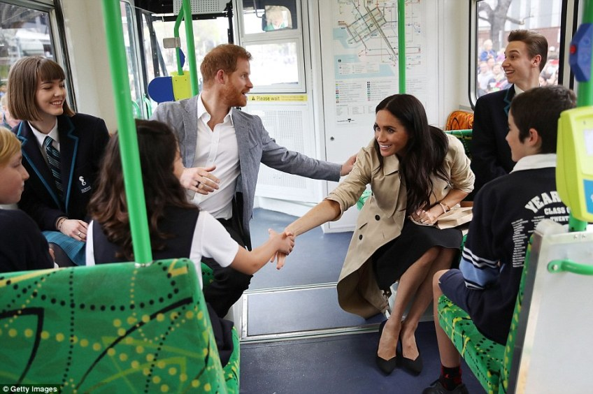 The couple took Melbourne's iconic tram system to the beach, catching it with student leaders at a local school