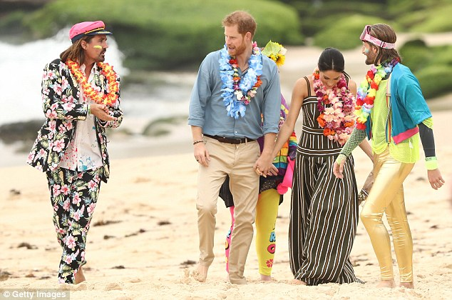 The couple (pictured) enjoyed taking part in the 'Fluoro Friday' session - within 20 minutes of the royal visit, OneWave's official website had crashed due to the volume of traffic