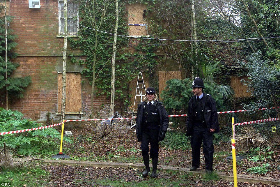 Two police officers stand outside the farmer's Norfolk home following the shooting in 1999
