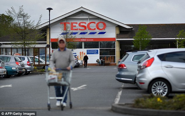 The duo was accused of being aware of revenue erroneously included in his financial records to reach targets and make Tesco (file image) economically healthier than it was