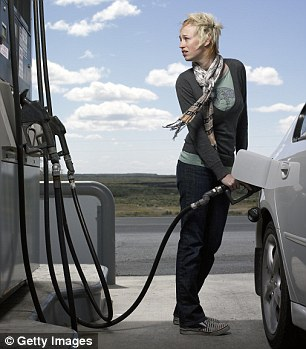 Dropped: Petrol prices fell in January, helping to ease budgets for UK motorists