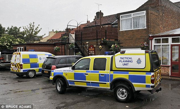 Police search a pub in York in 2009 after the disappearance of Claudia Lawrence.