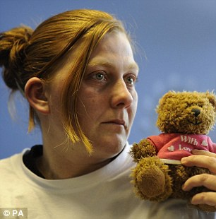 Matthews in March 2008 holding her daughter's favourite teddy bear as she feigned an emotional appeal for her safe return