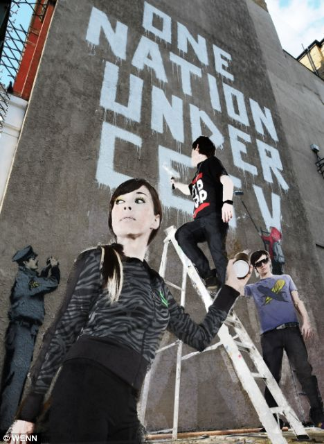 A new Banksy mural 'One Nation Under CCTV' painted next to a CCTV camera at a Post Office yard in the West End.