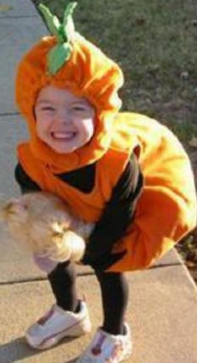 Swoop: Police fear a 'spotter' for a Belgian paedophile ring snatched Madeleine, pictured here dressed as a pumpkin for Halloween
