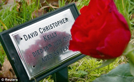 A red rose lies on the David Kelly's grave. But the story behind his death is not yet ready to rest in peace