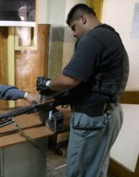 Gen Paktiawal's bodyguard, Bulldozer, with a PK machine gun