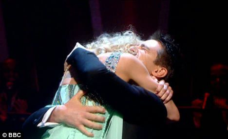 Favourites Tom Chambers and partner Camilla Dallerup embrace