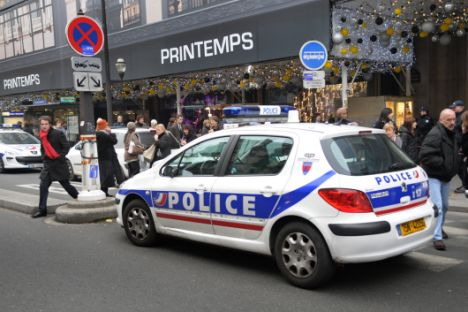 Anxious shoppers can be seeing fleeing the Printemps store in Paris today after five sticks of explosives were discovered