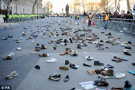 Hundreds of shoes litter Whitehall, near Downing Street (Mail Online)