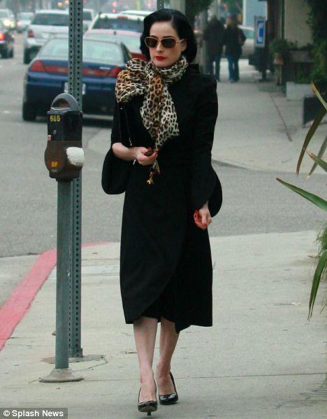 Dita Von Teese in towering heels for her journey home
