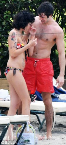 Amy Winehouse is spotted in the arms of an unidentified man on the beach in St.Lucia