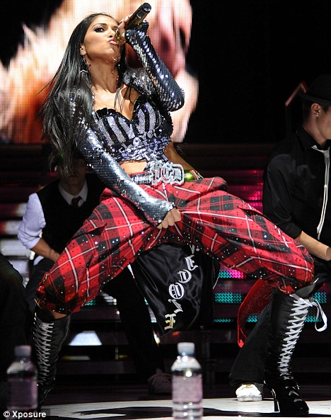 Lewis Hamilton's girlfriend Nicole Scherzinger in a graphic dancemove onstage with her band The Pussycat Dolls