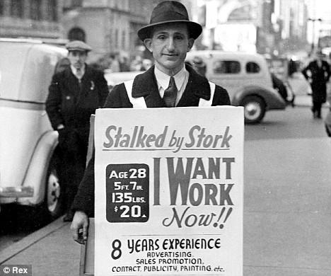 Jobseeking man with sandwich board