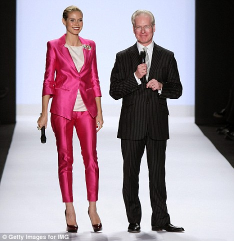 Towering beauty: At 5ft 9.5in Heidi overshadows Project Runway mentor Tim Gunn