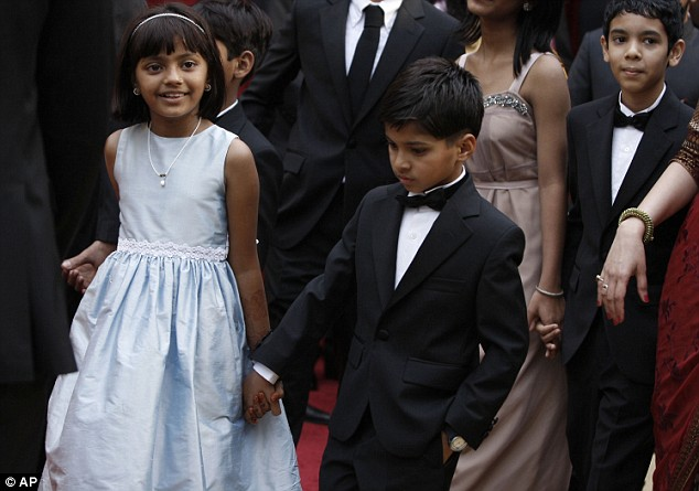 Child stars: Slumdog millionaire actors Rubiana Ali, left, youngest Latika, and Ayush Mahesh Khedekar, youngest Jamal, hold hands as they arrive for the 81st Academy Awards