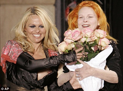 Not on her breast behaviour: Pamela Anderson's dress slipped down to reveal her nipple as she joined Vivienne Westwood on the catwalk