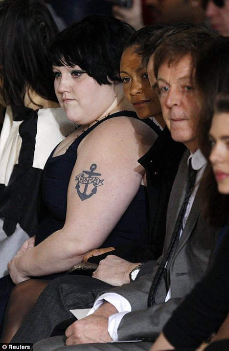 Beth Ditto (2nd L) and singer Paul McCartney (2nd R)
