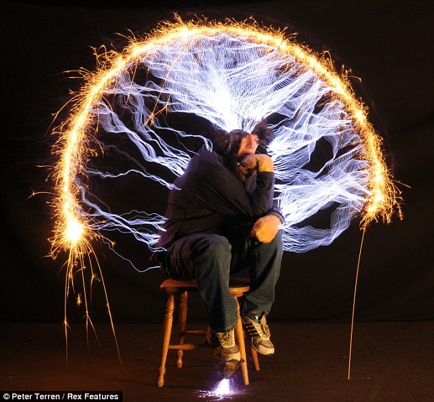It's electric: Peter Terren shoots 500,000 volts of electricity down his body as he sits in the pose of Rodin's 'Thinker'