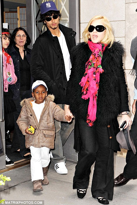 Madonna and Jesus Luz leave the New York Kabbalah centre earlier this year with her adopted son David Banda