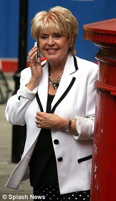 Gloria Hunniford speaks on her mobile phone in London