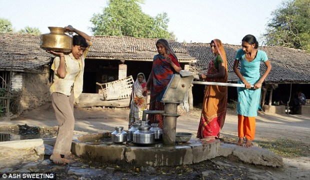 Collecting water from the village in Ranjit Nagar