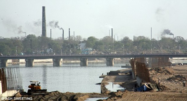 Bulldozers develop the river bank in Gujarat