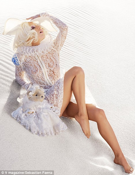 Just an innocent girl: GaGa shows her figure in virginal lace