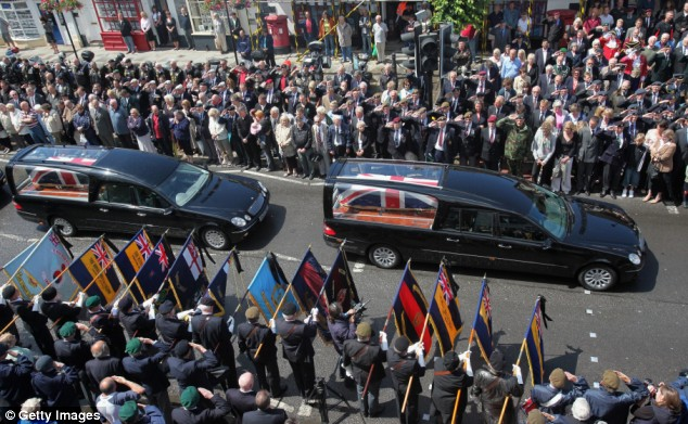Memorial procession: The coffins of Lieutenant-Colonel Rupert Thorneloe and Trooper Josh Hammond are driven past mourners in Wootton Bassett