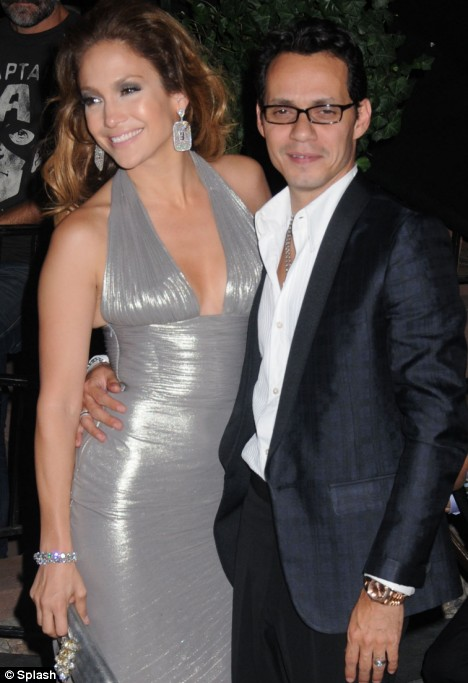 Sizzling in Silver: Jennifer Lopez and....him!