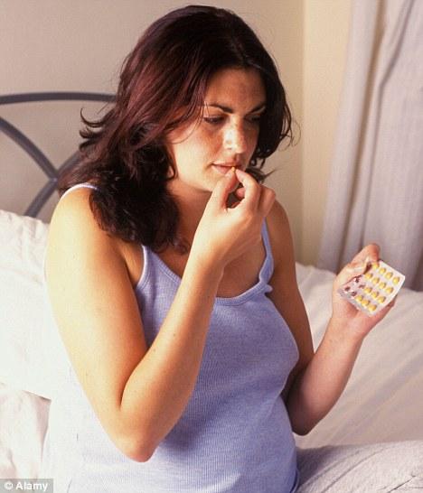 Pregnant woman taking pills