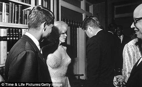 Inner circle: Marilyn with Robert (left) and his brother John F. Kennedy