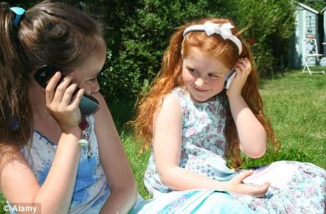 children talking on mobile phones