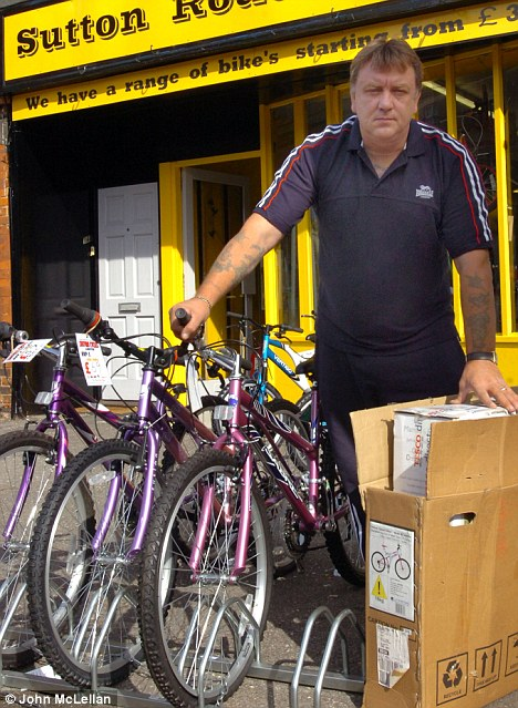 Green effort: Mark Howard, pictured outside his bicycle store, has labelled Southend Council's move to fine him as 'totally stupid'