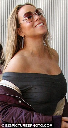 Mariah Carey Nearly Falls Out Of Her Top As She Celebrates