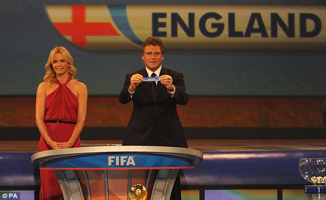 England's name is drawn by FIFA Secretary General Jerome Valcke as Charlize Theron looks on