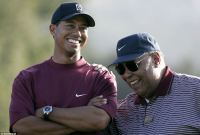 Tiger Woods with his father Earl on the golf course