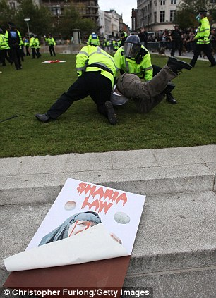 An EDL demonstrator is arrested at Piccadilly Gardens in Manchester